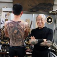 The Master: Horiyoshi III stands alongside a work in progress — some of which can take more than 100 hours to complete. | JON MITCHELL