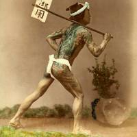 A tattooed post-runner delivers mail in Japan circa 1896. | ROB OECHSLE COLLECTION