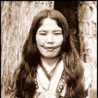 An Ainu woman with a face tattoo poses for a photo in Hokkaido circa 1910. | ROB OECHSLE COLLECTION