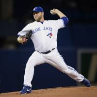 Seven up: Toronto starter Mark Buehrle throws a pitch against Los Angeles in the first inning on Monday night. The Blue Jays downed the Angels 7-3. | AP