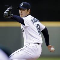 Red hot: Seattle starting pitcher Hisashi Iwakuma delivers during the Mariners' 2-1 loss to the Rays on Tuesday. | AP