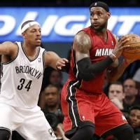 Tough battle: Brooklyn's Paul Pierce defends against Miami's LeBron James in the first half of Game 4 on Monday night. | AP