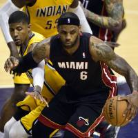 Follow the leader: LeBron James spins away from the Pacers' Paul George during the Heat's 87-83 win. | USA TODAY/ REUTERS