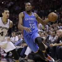 Pounded: Oklahoma City's Kevin Durant drives around San Antonio's Danny Green in Game 5 on Thursday night. The Spurs routed the Thunder 117-89 and lead the series 3-2. | AP