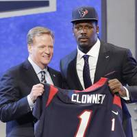 Great expectations: Defensive end Jadeveon Clowney poses for photographers with NFL commissioner Roger Goodell after being selected as the No. 1 pick in the NFL Draft by the Houston Texans on Thursday night. | AP