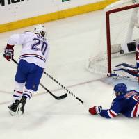 Shutout: New York's Henrik Lundqvist makes a save on a shot by Montreal's Thomas Vanek in Game 6 on Thursday night. The Rangers edged the Canadiens 1-0 to take the series 4-2. | REUTERS