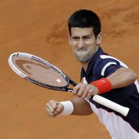 It's my time: Novak Djokovic begins to celebrate after the last point of his 4-6, 6-3, 6-3 victory over Rafael Nadal in the Italian Open final on Sunday in Rome. Djokovic dedicated the win to flood victims in his native Serbia. | AP