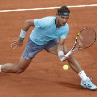 Clinical: Rafael Nadal plays a shot from Austria's Dominic Thiem in their second-round match at the French Open on Thursday. | AP