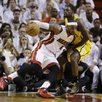Leaning in: Miami's LeBron James drives on Indiana's Lance Stephenson during Game 3 on Saturday night. The Heat beat the Pacers 99-87 to take a 2-1 lead in the series. | AP