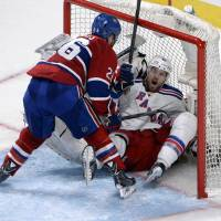Caught in a trap: Montreal's Josh Gorges bundles New York's Rick Nash into the goal during the Canadiens' 7-4 win on Tuesday. | REUTERS/USA TODAY