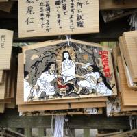 A shrine plaque shows gods who were involved in the Amaterasu Omikami cave myth, trying to pull the Sun Goddess from her hiding place. | MANDY BARTOK