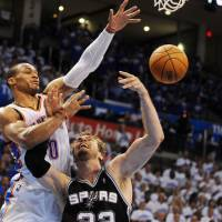 Thunderstorm: San Antonio's Tiago Splitter (below) attempts a shot as Oklahoma City's Russell Westbrook's defends during the Thunder's 105-92 win on Tuesday. | USA TODAY/REUTERS