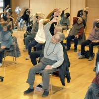 Stay healthy: Elderly residents of Kochi take part in exercises. The population in many parts of Japan is aging and shrinking. | KYODO