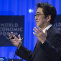 Man with a plan: Prime Minister Shinzo Abe speaks at the World Economic Forum in Davos, Switzerland, in January. | KYODO