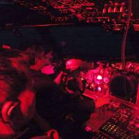 Crew members in the cockpit of a Maritime Self-Defense Force P-3C patrol plane watch out Thursday for vessels in the East China Sea during a nighttime surveillance training flight. | KYODO