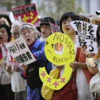 Protesters rally Thursday in front of the prime minister's office to oppose Shinzo Abe's drive to lift the nation's self-imposed ban on collective self-defense by reinterpreting the Constitution. | KYODO