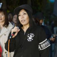 Misao Redwolf, a member of the Metropolitan Coaliton against Nukes, which has organized the weekly anti-nuclear protests by the prime minister's office since March 2012, speaks at a rally on April 25. | KYODO