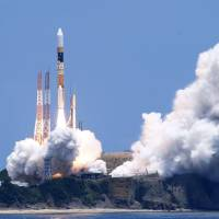 An H-IIA rocket carrying a new mapping satellite lifts off from Tanegashima Space Center in Kagoshima Prefecture on Saturday. | KYODO