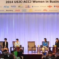 Prime Minister Shinzo Abe speaks during the opening ceremony of the 2014 Women in Business Summit at a Tokyo hotel on Tuesday. Abe has vowed to bolster the number of women in the workforce. | YOSHIAKI MIURA
