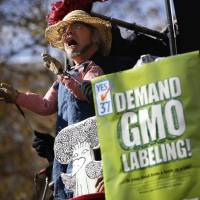 Hand in glove: A man performs in a puppet show during a rally in San Francisco, California, in support of a proposed initiative that would require mandatory labeling of genetically modified raw and processed food products. | REUTERS
