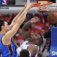 In your face: Thunder center Steven Adams dunks on the Clippers' Glen Davis on Friday in Los Angeles. | AP