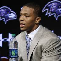 Saying sorry: Ravens running back Ray Rice speaks at a news conference alongside wife Janay on Friday. | AP