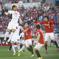 Face the facts: Cerezo Osaka's Yoichiro Kakitani attempts a header against Urawa Reds on Saturday in Saitama. Kakitani's effort was off the mark, as Reds claimed a 1-0 victory. | KYODO