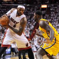 This is routine: The Heat's LeBron James is defended by the Pacers' Lance Stephenson in Game 6 of the Eastern Conference finals on Friday in Miami. The Heat won to clinch the series and return to the NBA FInals.   REUTERS