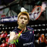 Smash and grab: Kenichi Tago plays a shot against China in the Thomas Cup semifinals on Friday. | KYODO