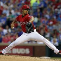As close as it gets: Rangers starter Yu Darvish pitches against the Red Sox during an 8-0 win on Friday in Arlington, Texas. Darvish threw 8⅔ innings of no-hit ball in the victory. | AP