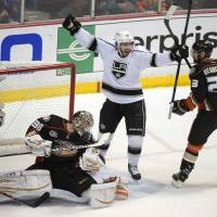 Long live the Kings: Los Angeles' Mike Richards (center) celebrates his goal as he stands between Anaheim goalie John Gibson and defenseman Francois Beauchemin (23) on Friday. | AP
