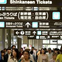 Signs in Japanese and English hang from the ceiling of JR Nagoya Station. | CHUNICHI SHIMBUN
