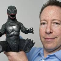 Attorney Aaron Moss of Greenberg Glusker shows a licensed, original Godzilla Imperial product at his office in Los Angeles on April 23.  | AP