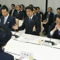 Prime Minister Shinzo Abe attends a meeting on increasing the ratio of foreign workers in Japan at the Prime Minister's Official Residence in Tokyo on April 4. Japanese often shun '3K' jobs that are 'kitsui' (difficult), 'kiken' (dangerous) and 'kitanai' (dirty). | KYODO