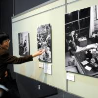People look at Tsuneko Sasamoto's photos at her exhibition, held at the Japan Newspaper Museum in Yokohama, on April 5. | SATOKO KAWASAKI