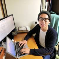 University student Yamato Aoki, who created a forum where high school students can communicate directly with Diet lawmakers, poses in his room in Bunkyo Ward, Tokyo, on April 28. | YOSHIAKI MIURA