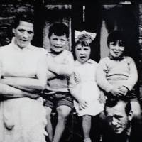 A family photograph, reproduced with permission from Helen McKendry, shows Jean McConville with some of her 10 children, including eldest daughter Helen (second from right), in Northern Ireland in 1972. McConville, 37, was abducted by the IRA in front of her children at her Belfast home in December 1972, shot dead and then secretly buried. She was accused of passing information to the British Army. | AFP-JIJI