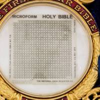 A 1.5 sq.-inch (3.8 sq.-cm) microfilm Bible that flew around the moon is seen in a picture from Heritage Auctions. | REUTERS
