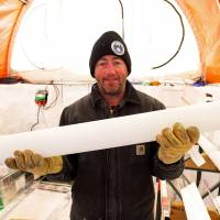 Aurora Basin Science leader Mark Curran holds a newly extracted ice core at the Australian Antarctic Division's drilling base camp in this recent picture. Polar scientists said Thursday they have successfully drilled a 2,000-year-old ice core in the heart of Antarctica to retrieve a record of how the planet's climate has evolved. | AFP-JIJI