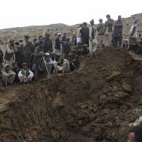 weight of the worldVillagers search desperately for people trapped by a massive landslide that struck the Argo district of Badakhshan province, Afghanistan, on Friday, with some estimates putting the death toll as high as 2,700 people on Sunday. | STORY: PAGE 4 AFP-JIJI
