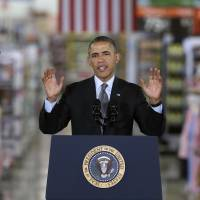 President Barack Obama speaks on renewable energy at a Wal-Mart store in Mountain View, California, on Friday. | AP