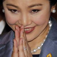 Former Thai Prime Minister Yingluck Shinawatra arrives at the Constitutional Court in Bangkok on Tuesday to defend herself against charges of abuse of power. | REUTERS