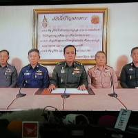 Gen. Prayuth Chan-ocha (center) becomes the face of Thailand's coup as he delivers a TV address to the nation Thursday. | REUTERS