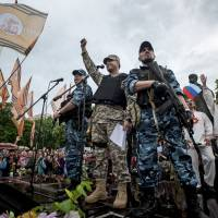 Pro-Russian activists rally in eastern Ukraine's Luhansk region Monday, following a referendum that asked residents if they supported independence from the country. The United States and other nations condemned the poll as unconstitutional, but Moscow said it would 'respect' the outcome of the vote. | AP