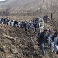 Afghan rescuers search for survivors after a massive landslide buried a village in Badakhshan province on Friday. | REUTERS