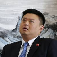 Wang Jing gives an interview at Beijing Xinwei Telecom's offices in Beijing in April. | REUTERS