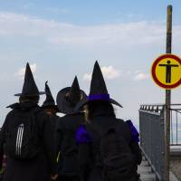 Women dressed as a witches walk at the summit of Brocken mountain in the Harz region to celebrate the Walpurgisnacht pagan festival on Wednesday. | REUTERS