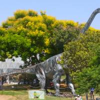 A nearly full-size model of an Argentinosaurus stands in the Clore Garden of Science in the Weizmann Institute of Science in Rehovot, Israel. | MATHKNIGHT AND ZACHI EVENOR