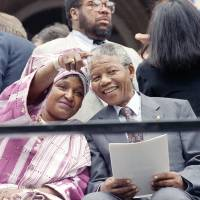 Nelson and Winnie Mandela attend a welcoming ceremony at New York City Hall at the start of their three-day stay in June 1990. | AP