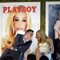 Cooper Hefner, the son of Playboy founder Hugh Hefner, chats with 2014 Playboy Playmate of the Year Kennedy Summers in Los Angeles on Thursday. | REUTERS
